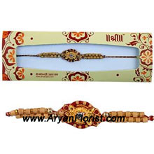 productMade with love, this Rakhi spreads love and light on the special occasion of Raksha Bandhan. Delicately created with beads, trinkets and knick-knacks, its charming design suits all wrists. Its small size adds to its elegance. Order it for your brother and let him know how much you love him.