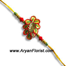 productDelicate rakhi, but strong bond; make your brother feel special on Rakshabandhan with this elegantly designed rakhi. Small in size and aesthetically created, it embodies the true love that brothers and sisters always protect. Order this Rakhi for your brother and share the love.