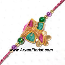 productAn assortment of color is styled to perfection in this designer Rakhi. Created with the finest beads, threads, and trinkets, this Rakhi will bring love, joy, and color into your brother�s life. A beautifully designed expression for a special bond, send it to your brother on Raksha Bandhan.