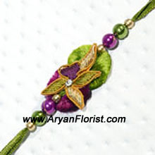 productA trendy rakhi, specially designed for your brother. This designer Rakhi is crafted from decorative beads, threads, and trinkets. Stylishly put together in an impressive design, this one stands out with its radiant colors. Order it for your brother on the special occasion of Raksha Bandhan.