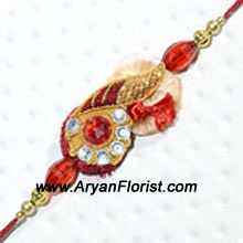 productThe true beauty of Raksha Bandhan is the bond that ties brothers and sisters. Here�s a Rakhi designed with intricate patterns with fancy embellishments, studs, beads and traditional threads. The Rakhi is neatly packed in fancy wrapping and delivered. Present it to your brother to express your love.