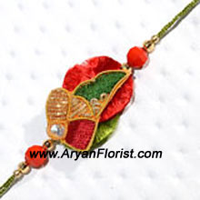 productColourful, trendy and exclusive, this Rakhi is sure to charm your brother on Raksha Bandhan. Decorative beads, detailed embellishments, and pretty trinkets form a charming pattern that is tied together with silky satin threads. Send this Rakhi to your brother and celebrate the festival with love.