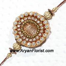 productA beautiful design, this Rakhi is made with the most dainty beads, trinkets, and embellishments. Its traditional design stands out for uniqueness and beauty. Send it to your brother along with sweets and flowers to make Raksha Bandhan even more special for him.
