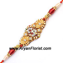 productThis unique Rakhi symbolizes the special bond that�s shared between brothers and sisters. Crafted with sparkly beads, trinkets, and colorful knick-knacks, the beautiful pattern is sure to delight your brother. Order it and we will creatively wrap it and deliver it with love.