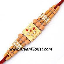productAn enchantingly designed Rakhi for a special occasion, this Rakhi embodies all the love and care that sisters and brothers share. Crafted with beautiful beads and embellishments, its traditional pattern is subtle and elegant. Order it to be sent to your brother for Raksha Bandhan.
