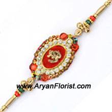 productLovely trinkets are put together with decorative beads and tied together with traditional threads in this trendy rakhi. Its unique pattern stands out. Delight your brother by sending this Rakhi to celebrate Raksha Bandhan.