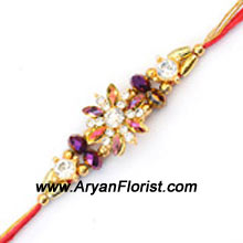 productCelebrate the special bond you share with your brother on this Raksha Bandhan with this gorgeous rakhi. Designed with colorful beads and trinkets, it is the perfect representation of your lovely relationship with your brother. The Rakhi gets delivered creatively wrapped in fancy packing.