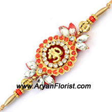 productThis Rakhi designed in a traditional pattern is crafted with decorative beads, sparkly embellishments and silky threads, all coming together to form a beautiful design. Impress your brother with this wonderful Rakhi and celebrate the festive occasion.