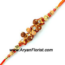 productA quirky design for those who love all things different. This Rakhi features striking embellishments coming together with colorful threads to form an amazing pattern. Send it to your brother and make Raksha Bandhan even more special.