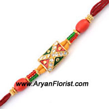 productCelebrate the special times you share with your brother this Raksha Bandhan with this pretty rakhi. Designed with colorful beads and trinkets, it is the perfect representation of your adorable relationship with your brother. The Rakhi gets delivered creatively wrapped in fancy packing.