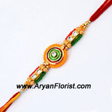 productA charming Rakhi for your charming brother, this Rakhi is created with embellishments, beads, and trinkets that create an impressive traditional design. Make Raksha Bandhan even more special for your brother by sending this Rakhi to him, wrapped with love and packed with care.