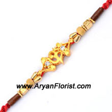 productThis decorative designer Rakhi is created with the finest details. Circular beads and trinkets are threaded together to embody the bond of love that you share with your brother. The Rakhi is beautifully wrapped and delivered with lots of love. Order it for your brother along with sweets and flowers and make the day even more special.