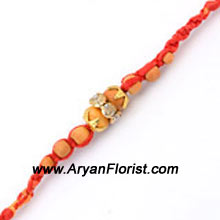 productCelebrate the emotional bond that you share with your brother with this Rakhi. Detailed embellishments and trinkets are put together to create the most stunning Rakhi. Beautiful, stylish and auspicious � it is a perfect expression of your love to be shared this festive season of Raksha Bandhan.