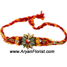 productThis trendy Rakhi is a perfect way to celebrate your special bond and love for your brother. Created in a fascinating design with detailed trinkets and embellishments, it comes packed in a fancy package and is wrapped in love. Order it and delight your brother.