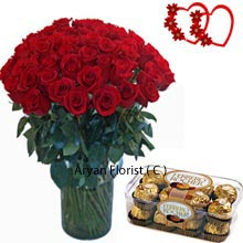 productWhen it comes to showing love and affection for other person, flowers and chocolates are the best. This set of 36 lovely roses in a vase and a box of 16 Pieces Ferrero Rocher chocolates makes a perfect combo for the special one with a sweet tooth. This combo present showers all the love and affection; elegant roses and superb fragrance melts everybody heart. The nice creamy chocolate does a lot in creating the magic of love. Roses placed in vase so beautifully that one cannot just take the eyes away from them. A delicious chocolate adds on the style of affection and changes the surroundings.