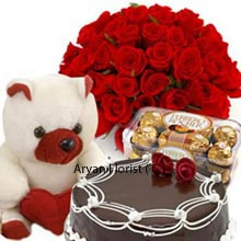 productThis exclusive collection contains a Basket of 36 Red Roses, Chocolate Truffle Cake weighing 1/2Kg (1.1 Lbs), Box of 16 Pieces Ferrero Rocher Chocolates and a Small Teddy Bear. A whole lot of items to be discovered in this package. Plunge into the intense chocolates, truffle cake and cuddle the delicate teddy and finally impress your love of life with gorgeous roses. Be ready to celebrate the precious moments for any occasions knocking at the door.