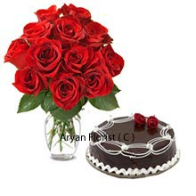 productCakes with roses are the wonderful gift for every celebration. Attractive 12 red roses placed in the vase along with 1 kg(2.2 Lbs)Chocolate truffle cake are bound to make the day for someone special. Delicious cake and fresh flowers are made to create the event more memorable for you and your special one. While the cake is baked with love and is great in taste, the red roses spread the fragrance of love. The combo is suitable for birthdays, anniversary and any celebration. It is finely designed for your special day to make it way more special.