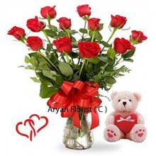 productFlowers are the perfect gift for all occasions. Stunning 12 red roses tied elegantly with the satin ribbon in the vase along with medium size teddy bear with a heart is the amazing gift to soften someone's, special heart. This can be bound to bring the smile to someone's special and additional love. This elegant surprise will for sure make you fall in love and make you feel special all over again. A teddy with heart and red roses is idolized and appreciated by all and of all well worth the value.