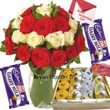 productValentine day is the day of love and most precious gift you can give to your loved ones is an amazing combo gift. This combo product has the bunch of 24 roses with 12 red roses and 12 white roses placed elegantly in a vase along with the message of love with Valentine card. For the love of sweets the wonderful gift includes 1 box of assorted sweets, and not to forget the pair of dairy milk chocolates. An exquisite�gift combined�particularly�to make�the magic�of affection�direct from heart to heart.