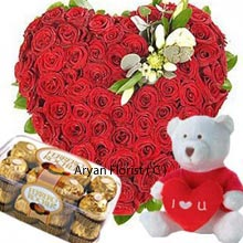 productThis fascinating Heart shaped arrangement of 100 Red Roses, medium sized cute Teddy Bear with a heart and a Box of 16 Pieces Ferrero Rocher Chocolates for your beloved one is the best option for expressing the gratitude and charm of your relationship. Price cannot be a bar for special relations, hence not even thinking once this can be a very good choice to celebrate your day of love. Be happy and make them happy.