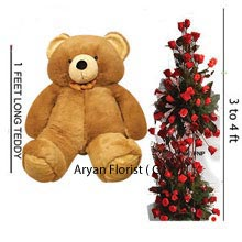 productThe glorious bunch of 200 red roses is placed in a fashionable way from top to bottom. It is so wonderful to touch the soft, fresh red roses. The fine arrangement of 3-4 feet flowers and the 1feet tall teddy bear surely will fill one's eyes with tears of joy. These roses are going to titillate the senses at every corner of the room with their fragrance. A beautiful combo pack that creates the magic of love and this special gift would definitely be an enthralling experience.