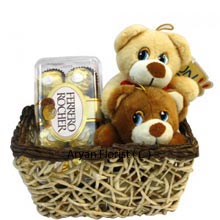 productA perfect sorry combo is this! 2 teddy bears that are inseparable, and are planted in a lovely brown woven basket are part of this all sweet combo. This basket comes with a box of 16 pieces of Ferrero Rocher to transform any bitter and crunchy memory into a sweet and unforgettable one! This pack will make you ponder on all the vows you took together and will reinstate the strength in your relationship. (This Product Needs To Be Accompanied With Flowers )
