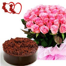 productA pretty couple pack including a Bunch of 50 Pink Roses with 1Kg (2.2 Lbs) Chocolate Cake is available for the ones who want to spend their personalized occasions in a special way. These elegantly arranged roses are sure to steal hearts and the cake made of pure chocolate will make your tongue lick time and again. Gift this pack to your friends, colleagues, parents, siblings and partner with a big smile and receive a warm touch of love.