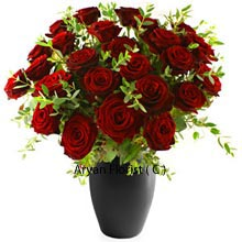 productBlack Vase containing 30 red roses, looks like they are growing from the vase itself as they are so well placed with greens rightly placed amidst them. Looking at as many as 30 red roses together, your eyes will sparkle and your heart will praise the bouquet. The Vase is also strong and looks perfect in contrast with the red roses. It can be reused after the roses dry up and can adorn your center table. Buy now!