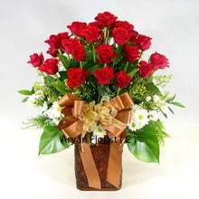 productWhen planning to give flowers, roses are always on the top priority. With that in mind, we have created this beautiful bunch of 24 red roses and present to you in a lovely wooden vase. The wooden vase makes this bunch appear like they have just been bought from the woods. The ribbon that is transformed into a bow adds to the vigor and gives the whole bunch a contemporary feel. Further, these are decorated with the greens and other small contrasting flowers. Go for this without much ado!