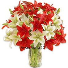 productLilies are allusive of innocence and it should be your first choice if you are buying it for an innocence person whom you love dearly. It is very important to send correct flowers to anyone to recreate and maintain the magic of relationship, as flowers speak their own language. We present to you mixed colored flowers that you ought to choose as they come with a glass vase in which the flowers are placed. Place your order now and make the righteous choice for right people.