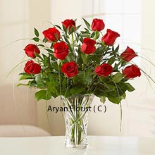 productA flower bouquet of 12 Red Roses in A Vase with Fillers can immediately bring smile to the person receiving this special gift. Flowers are a way to the heart and when it comes to red rose it just enchants the mind like nothing else. A special gift to your special one on a special day and express your true feelings without speaking even a word. Rule their world with this beautiful red rose bouquet.
