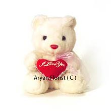 When love is in the air, this cute medium size teddy bear makes the days all the more special. Holding a heart in its hands, the teddy bear looks adorable and cute. Order it for your loved one and express your feelings on special occasions such as birthdays, Valentines Day or make it a bon voyage gift, a welcome back surprise.