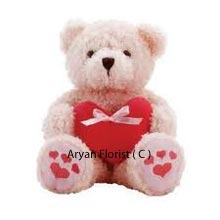 Wrapped with oodles of love, send this medium size teddy bear holding a heart in its hand to your special ones. Make her day special with a cute surprise. This soft fur teddy is a perfect gift to melt her heart. Send it to her to say sorry or express your love on your anniversary day, the teddy makes all occasions special.