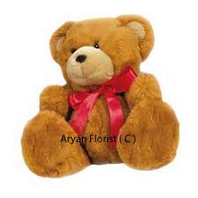 This is your find, if you are looking for fairly tall, dark and handsome Teddy Bear! With its height being just apt, 1.5 Feet Tall Teddy Bear is ready to hug you sincerely. It stands with a pride and indeed is one of the most cuddly bear to buy. It's soft fur and the pink ribbon enhances its beauty and makes it very worthy to be bought for someone you care. ( Please Note That We Reserve The Right To Substitute Any Product With A Suitable Product Of Equal Value In Case Of Non Availability Of A Certain Product )