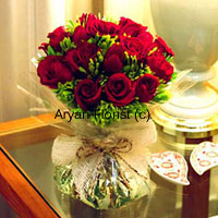 productSend this to your friends and family members on days that they need you by their side. When they aren't feeling well, this bunch of 12 red roses beautifully placed in a glass vase will bring happiness to them and speedy recovery. Let them know that you love and care for them. The fragrant roses spread joy and brightness alike.