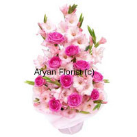 productAn outstanding combination of pink Roses with Gladiolus steal the heart at once. It's like love at first sight as the flowers are beautifully placed just like a royal carnation. If your loved ones live in a distant place, you must order this set of beautiful basket of flowers depicting the warmth with which you have sent them. The full bloom Gladiolus with big pink rose buds appear to smile back at you when you order them!