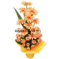 productOne of the most popular flower that is used for decoration in bunches, bouquets and carnations are the beautiful Gerberas. These orange Gerberas with Orange roses makes a heavenly looking set of cut flowers that are artistically placed. The orange colors of the flowers is emanating sunshine and the warmth of it. This beautiful carnation loudly conveys a message 'Let there be light', so it can be given to strengthen relationships. Place your order now!