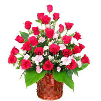 productThis extravagance will easily capture anyone's heart. A bunch of 24 red roses in a pretty cane basket, this piece of beauty is put together and enriched with fillers. Perfection of the expert florist unites with the beauty of red roses in a woven cane basket that adds the charm. Each flower is made to stand out while large green leaves drop gracefully around them. No hassles in carrying or displaying this bouquet that is carefully created choosing only the best.