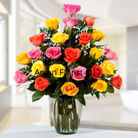 productDouble up the charm with two-dozen roses in different colours. Bright yellow, charming red, vivacious orange carefully arranged with fresh green leaves and fillers, this bunch is placed in a clear glass vase. The minimal design of the vase heightens the look of the roses further. Easy to carry, easy to display and care for, this one is a perfect gift for personal and business occasions.