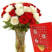 productWhat happens when you put stunning red together with classy white? You get to express your emotions in the most exquisite manner. This bunch of 12 red and 12 white roses is beautifully arranged in a tall glass vase and comes with a complimentary greeting card. Sweet smelling and bountiful, it is designed by expert florists who have handpicked each rose to create a perfect gift. This one is sure to beautify every place and every occasion.