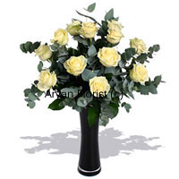 Yellow and bright, this bunch of 12 yellow roses brings sunshine along with it. Decorated with ferns and leaves in a glass vase, these yellow roses guarantee to brighten the occasion and the mood. Place near the windowsill or on the dinning table and it's sure to light up the world. The vase is specially selected to team up with the roses. This one makes for a great gift for those who love all things bright.