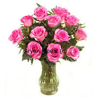 12 pink roses smelling as fresh as mist, this bunch in a vase makes for a sweet surprise for every occasion. Hand gathered roses from fresh farms and put together by expert florists, this bouquet is specially designed with ferns that add to the appearance. The glass vase adds to the classic look and feel of this bunch of pink roses. Surprise those who love pink!