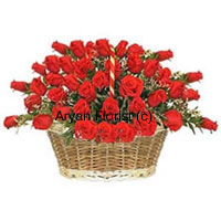 productFor those sweet celebrations, this basket of 50 red roses in an extravagant display of beauty will do the trick. Neatly arranged in a cane basket with a handle, the roses are displayed in a manner that each bloom stands out tall. The basket makes it easy to carry the flowers and to place it on any table. Green leaves and fillers are interspersed with the flowers to heighten the display. This one is a favourite choice for many occasions.