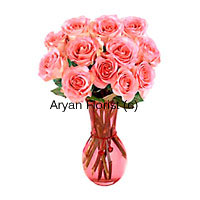 productThis arrangement is created of 12 pink roses in a fancy glass vase. Each long stem rose is handpicked by our expert florists and arranged carefully. The softness of pink and mesmerizing smell is sure to spread happiness all around. This one is a favourite for baby showers, birthdays and anniversaries. Gift it to friends and loved ones.