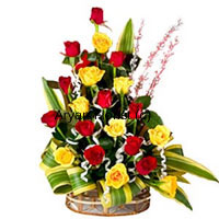 productThis basket of a dozen yellow and a dozen red roses in a creative conical design not only looks different, it is something that is specially created for those that stand out. The 12 red and 12 yellow roses with long stems have been selected by our expert florists for this structured bouquet. Add to the roses a bunch of seasonal fillers. The fancy round basket made of cane adds to the eccentric look. This piece makes for a great present for professional or personal occasions.