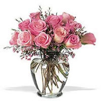 product12 pink roses are neatly placed in a clear glass vase. Fresh ferns hang graciously amidst the pink roses. The vintage shape of the glass vase adds a classic look. This one makes for a sweet surprise for your friends and loved ones. Place it on a centerpiece or on a dinning table, and it will brighten up the space as well as everyone's day. Medium in size and elegant, this classic arrangement suits all occasions.