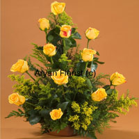 productAt once bright and attractive, this bunch of 12 yellow roses is sure to brighten up your friend's day. Creatively designed along with fillers and green leaves, each of the roses is placed in such a manner that it's brightness and beauty is easily highlighted. Surprise your friend by sending this to their home or office on occasions such as friendships day, a new job, a new house or just to let them know you're there.