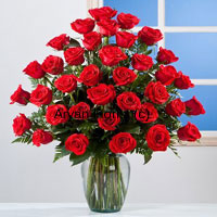 productThree dozen roses are put together in a casual yet charming fashion in this arrangement. The 36 red roses are fresh and handpicked by expert florists. The glass vase is simple, yet elegant. Long stems of the roses are seen through the clear glass, adding style to this creation. The roses remain as fresh as they are in the farm. Mothers day, daughters day, birthday or a job promotion, gift this on any special occasion.