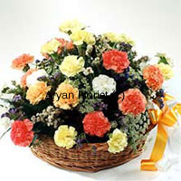 productAn adoring bouquet created with 24 mixed coloured carnations and seasonal fillers, this one is an absolutely stunning choice. Put together in a beautiful cane basket the carnations and fillers are playfully placed along with each other. Fancy ribbon tied to the basket completes the look. The flowers look and stay so fresh they remind of a garden.