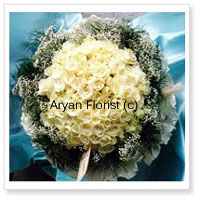 There are few things as pure and soft as white. This bouquet is made of 100 white roses and seasonal fillers. Keeping it simple and classy, the white roses are surrounded by fillers and wrapped with fancy wrapping. Easy to carry and place on any tabletop, this one goes well for business or personal gifting.